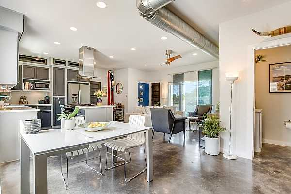 Photo #7 The dining area is adjacent to the kitchen so you can mingle with guests while preparing a festive meal.