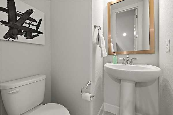 Photo #13 Powder bath, located on level 2 just at the top of the stairs, is perfect for guests.
