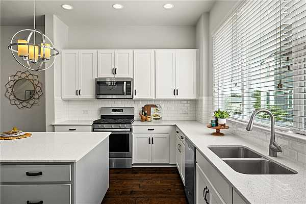 Photo #23 Stainless appliances and quartz counters bring a clean look to this modern kitchen.