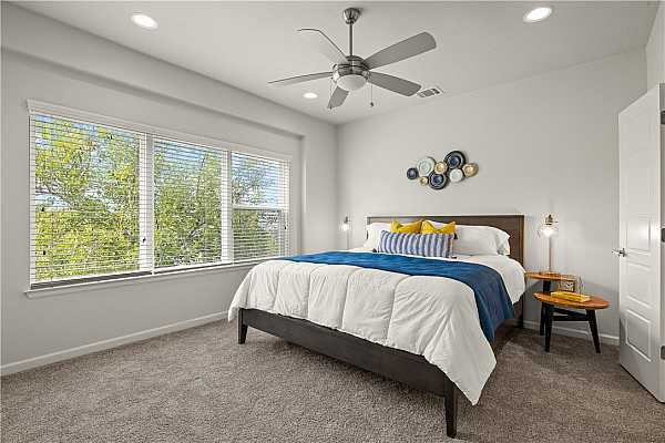 Photo #25 Located on level 3, the large primary bedroom features recessed lighting and double closets.