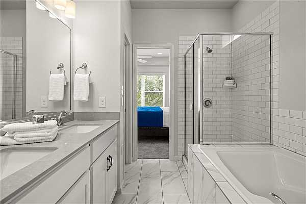 Photo #29 Separate walk-in shower with glass enclosure.
