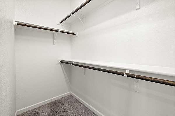 Photo #30 Second closet for primary bedroom is located off the primary bath.