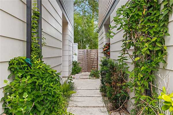 Photo #4 Quaint path leading to the front door and gate to backyard.