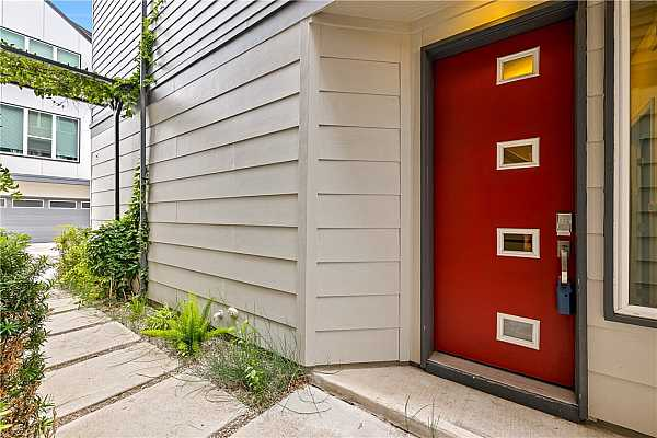 Photo #5 Modern red front door greets your guests.