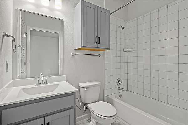 Photo #8 En suite bath located off of bedroom #1 on the lower level.