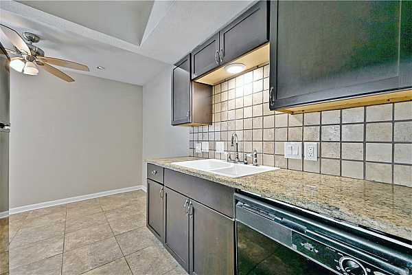 Photo #12 The backsplash catches accents from the tiled flooring, making the space cohesive.