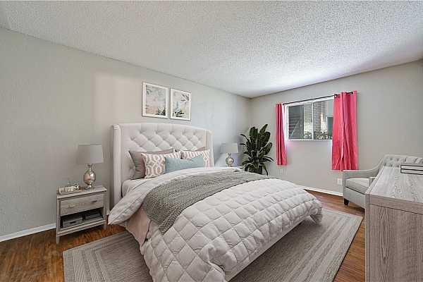 Photo #18 The primary bedroom has been virtually staged, allowing you envision this spacious room.