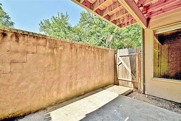 Photo #31 A gate offers easy access to the parking lot or community grounds.
