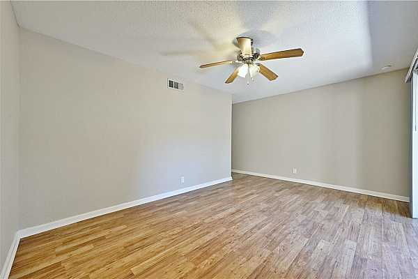 Photo #7  Light colored flooring makes the space feels bright and open.