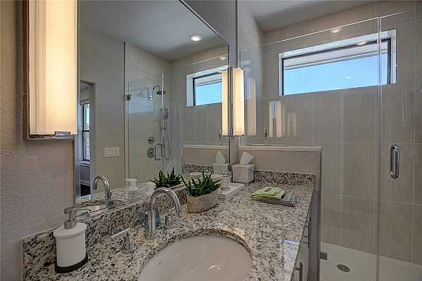 Photo #25 Upgraded Granite counter tops and frameless walk in shower.