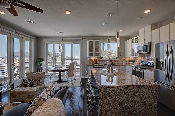 Photo #9 Beautiful natural lit living space with automatic blinds.